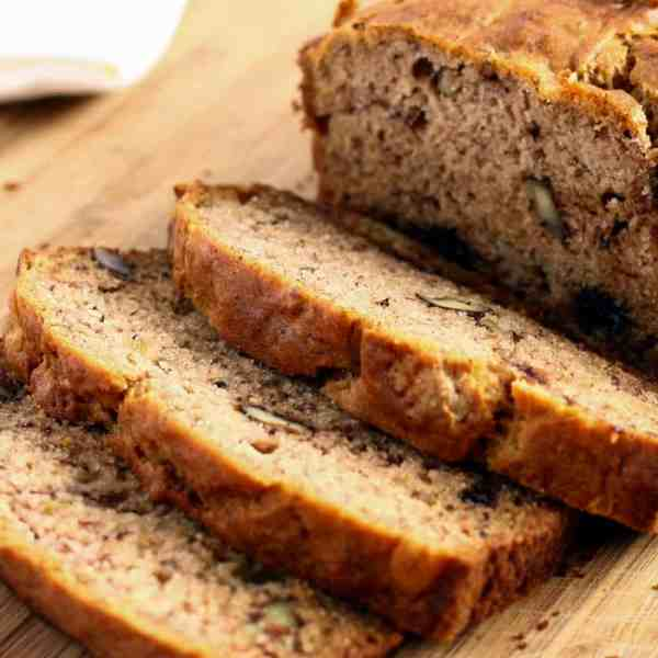 banana bread slices on wood cutting board