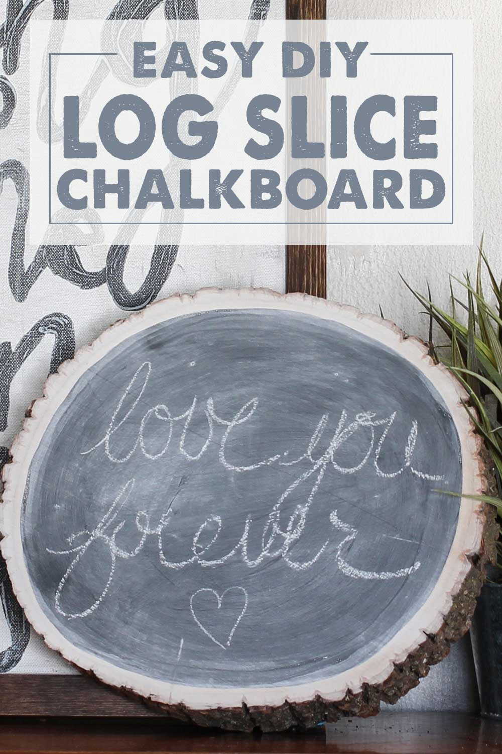 log slice painted with chalkboard paint and drawn on with chalk