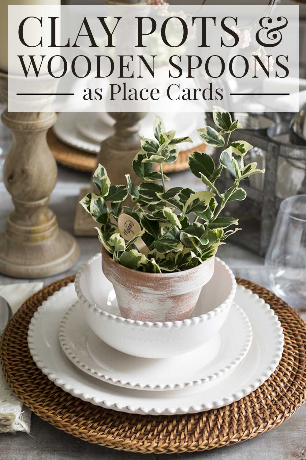Spring table setting, clay pot and wooden spoon as place card with greens