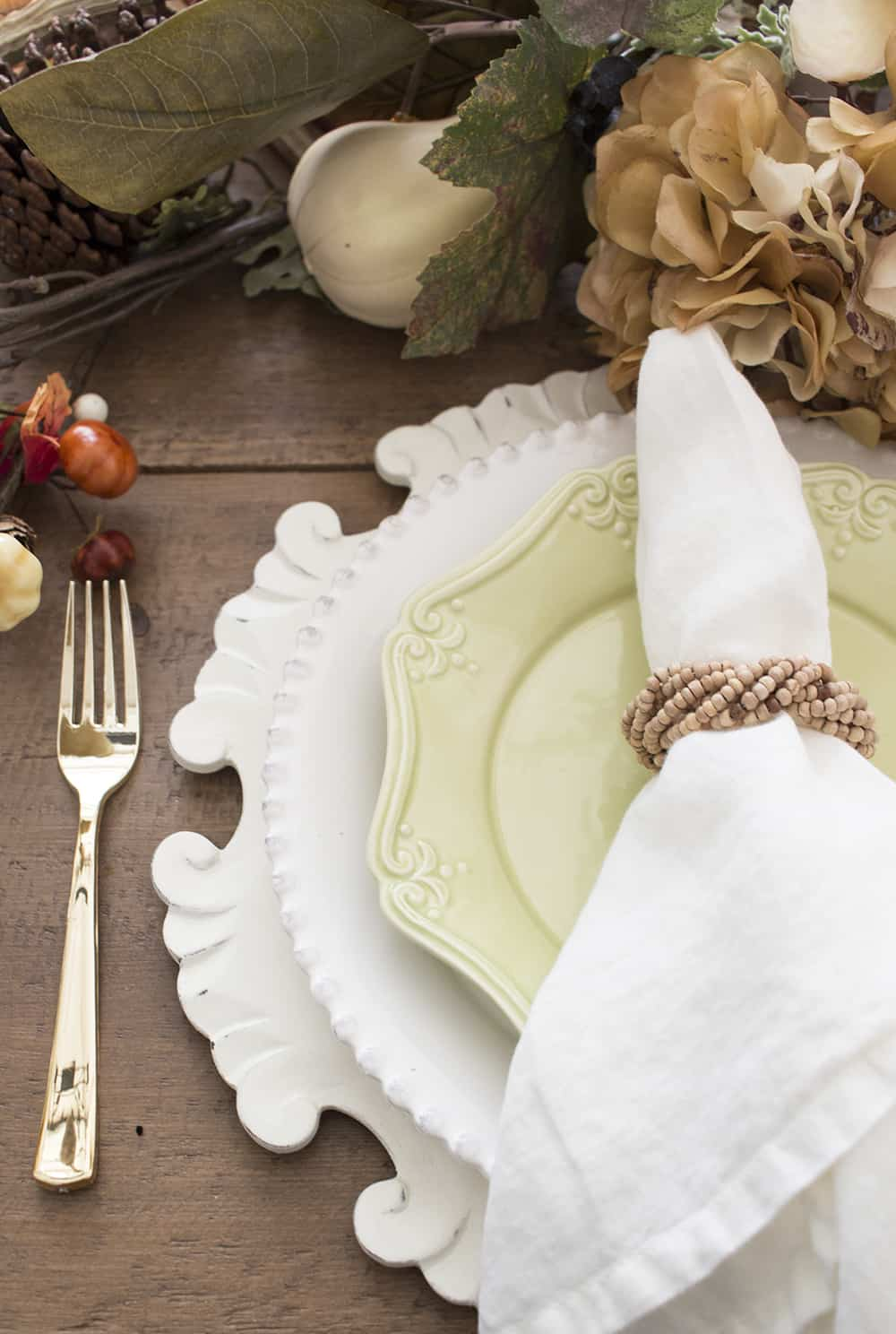 cream charger white and green plates
