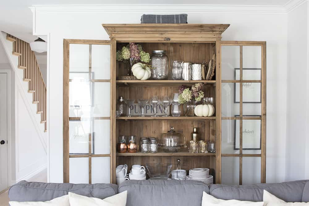 glass door wood bookcase doors open