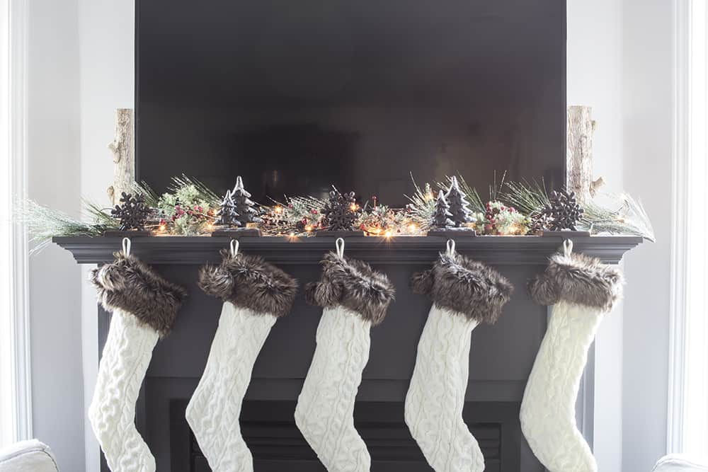 Fill in gaps in garland with greenery sprigs and sprays