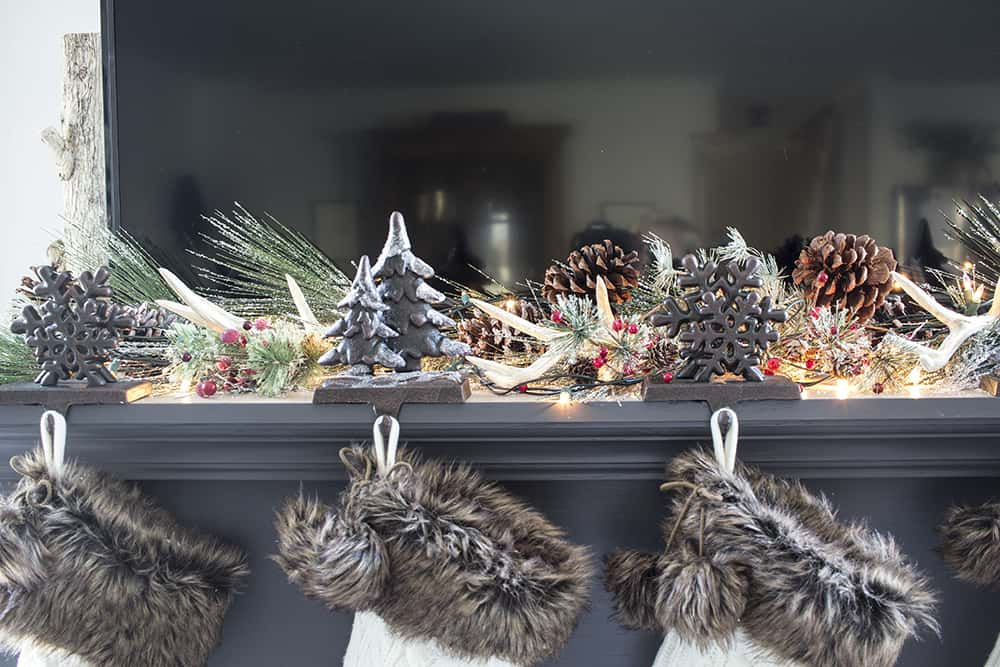 Traditional Christmas mantel decor with a TV