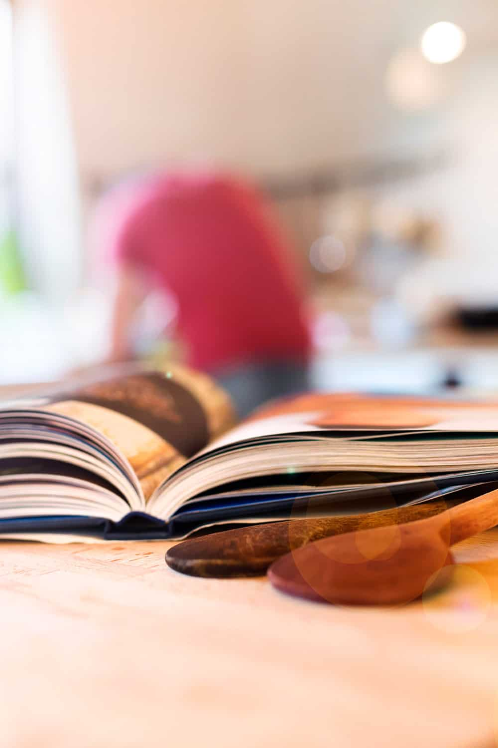 open cook book on kitchen counter