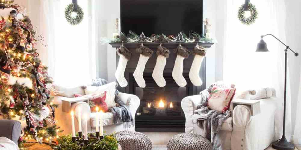 farmhouse living room fireplace with knit stockings and