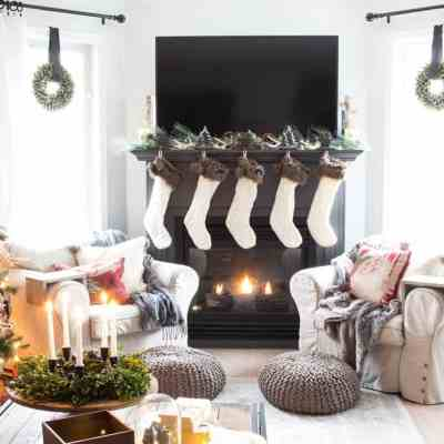 Farmhouse-Living-Room-Fireplace-with-Knit-Stockings-and-TV-on-mantel