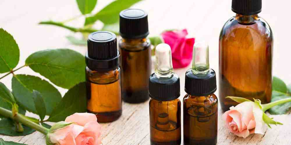 essential oil bottles with roses