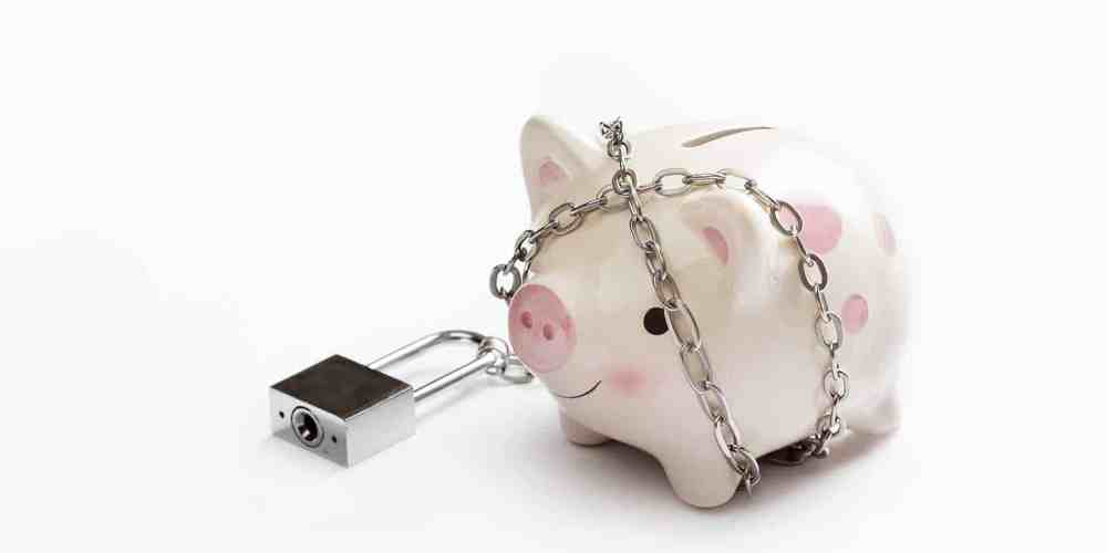 piggy bank in chains