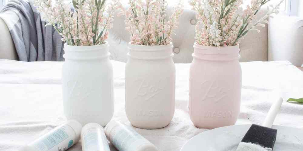 Ombre Blush Pastel Painted Mason Jar Vases filling vases with flowers