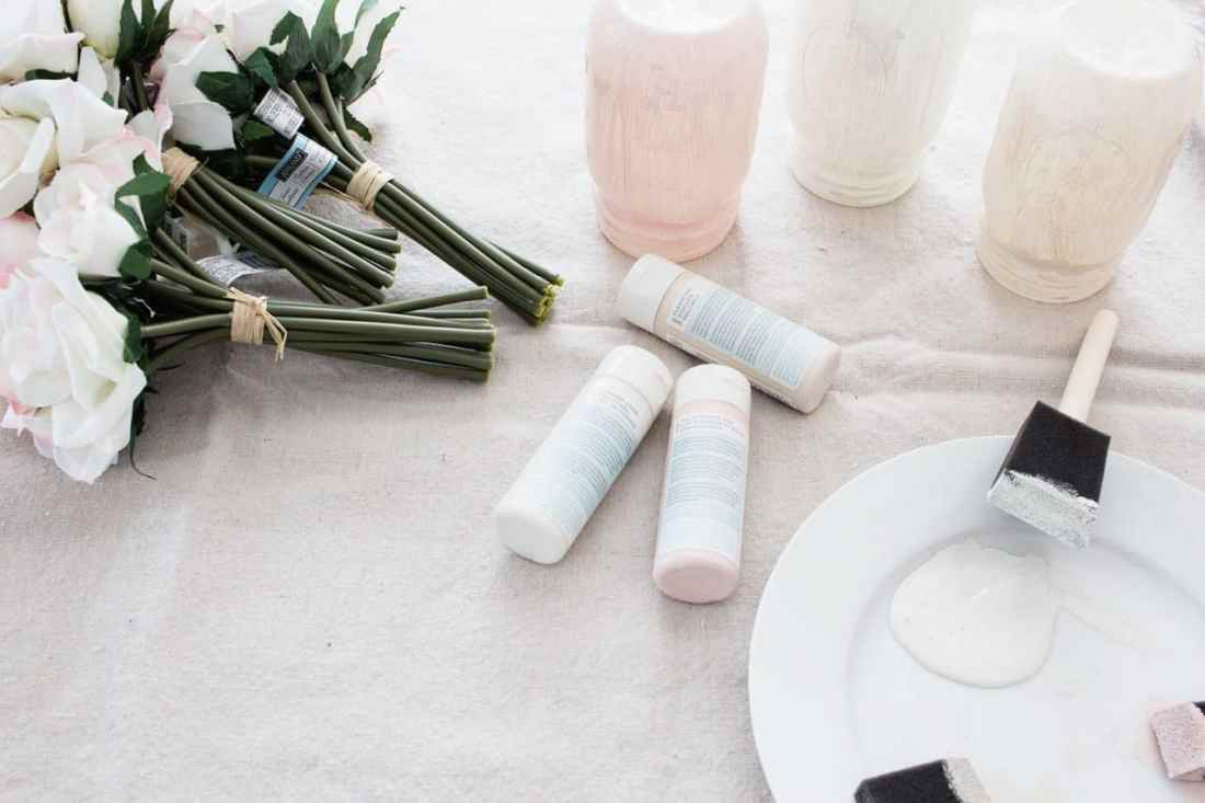 Ombre Blush Pastel Painted Mason Jar Vases supplies: mason jars, faux flowers, pastel paint, foam brushes and plate