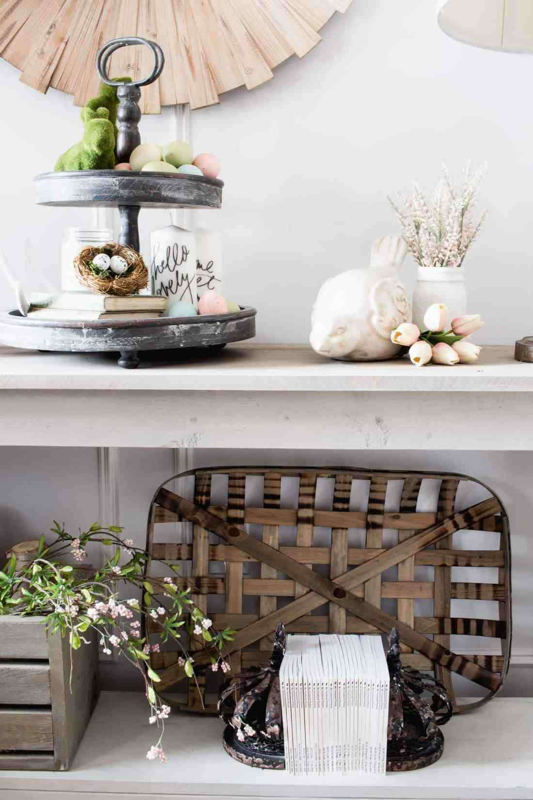 tabacco basket and crate on farmhouse entry table with spring flowers