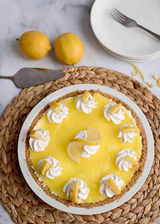 Garnished lemon cream pie in graham cracker crust