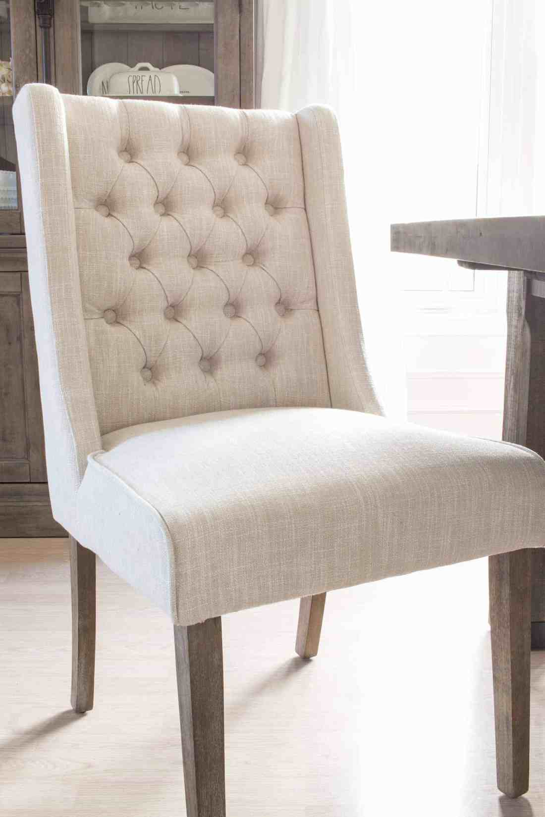 Caroline Wing Back Chair from The Brick, wood detail