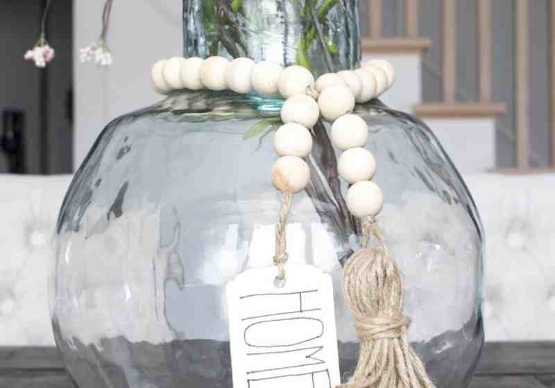 wood bead garland on demijohn