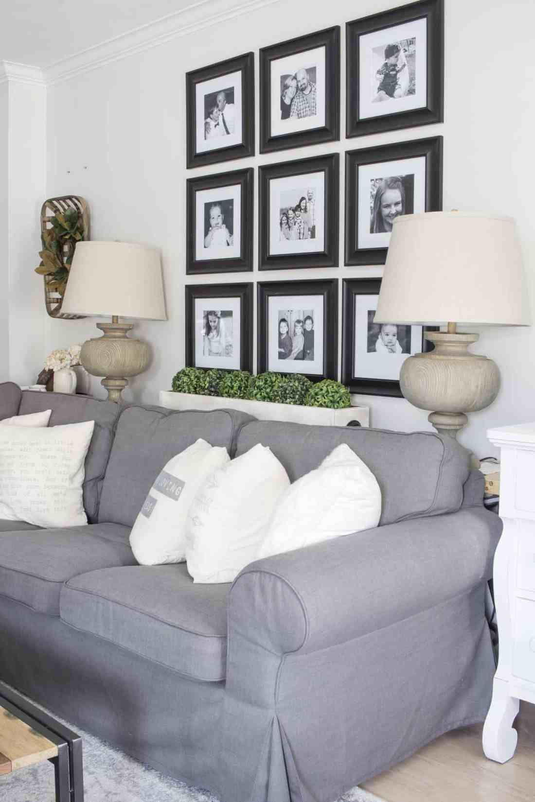 black and white grid gallery wall behind sectional couch