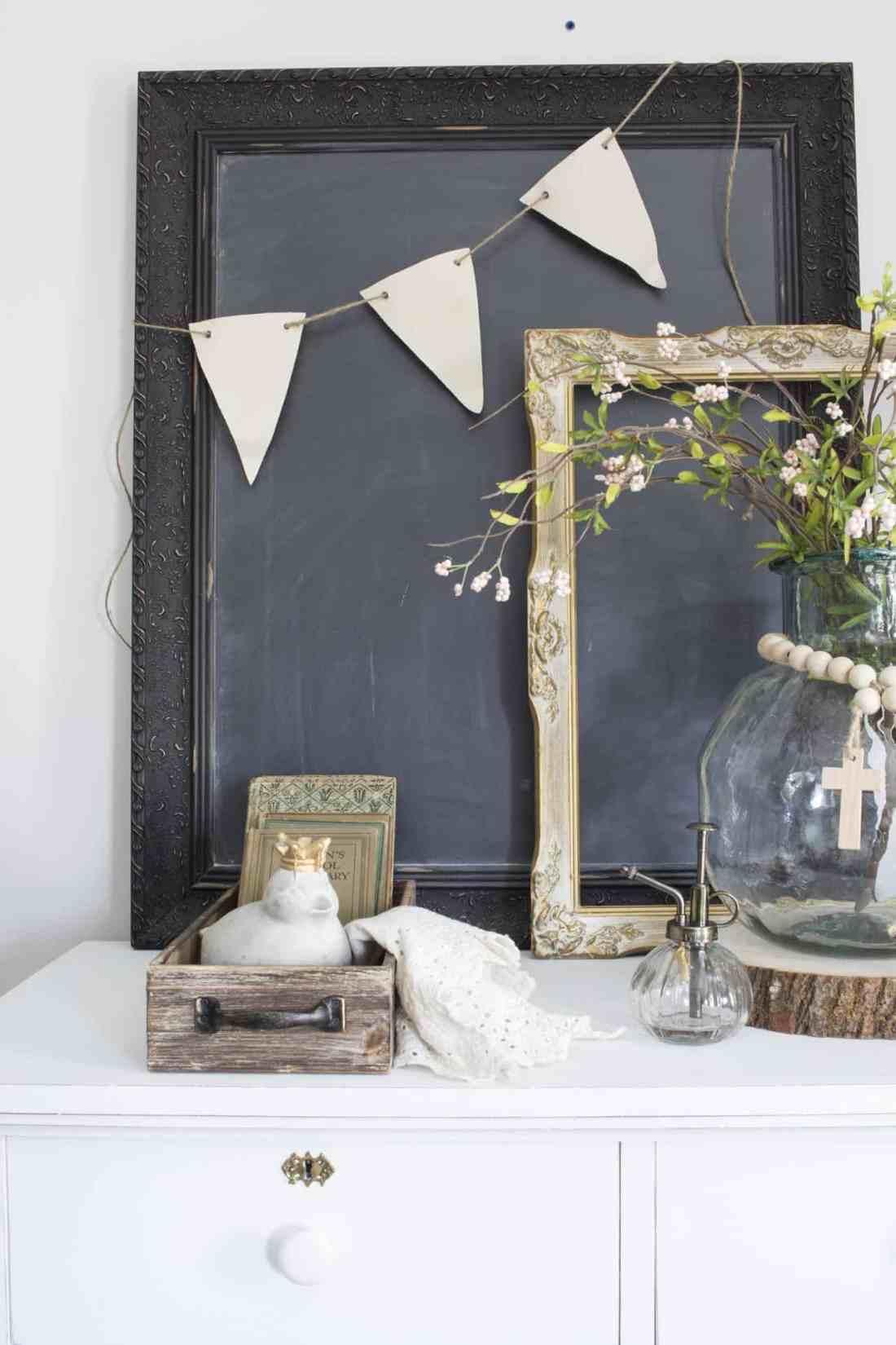 farmhouse vignette on dresser in living room