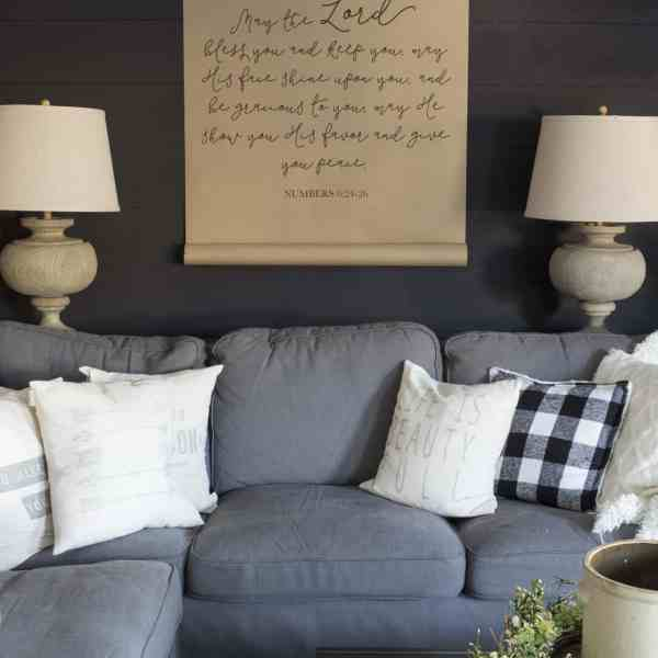 black shiplap wall with scroll