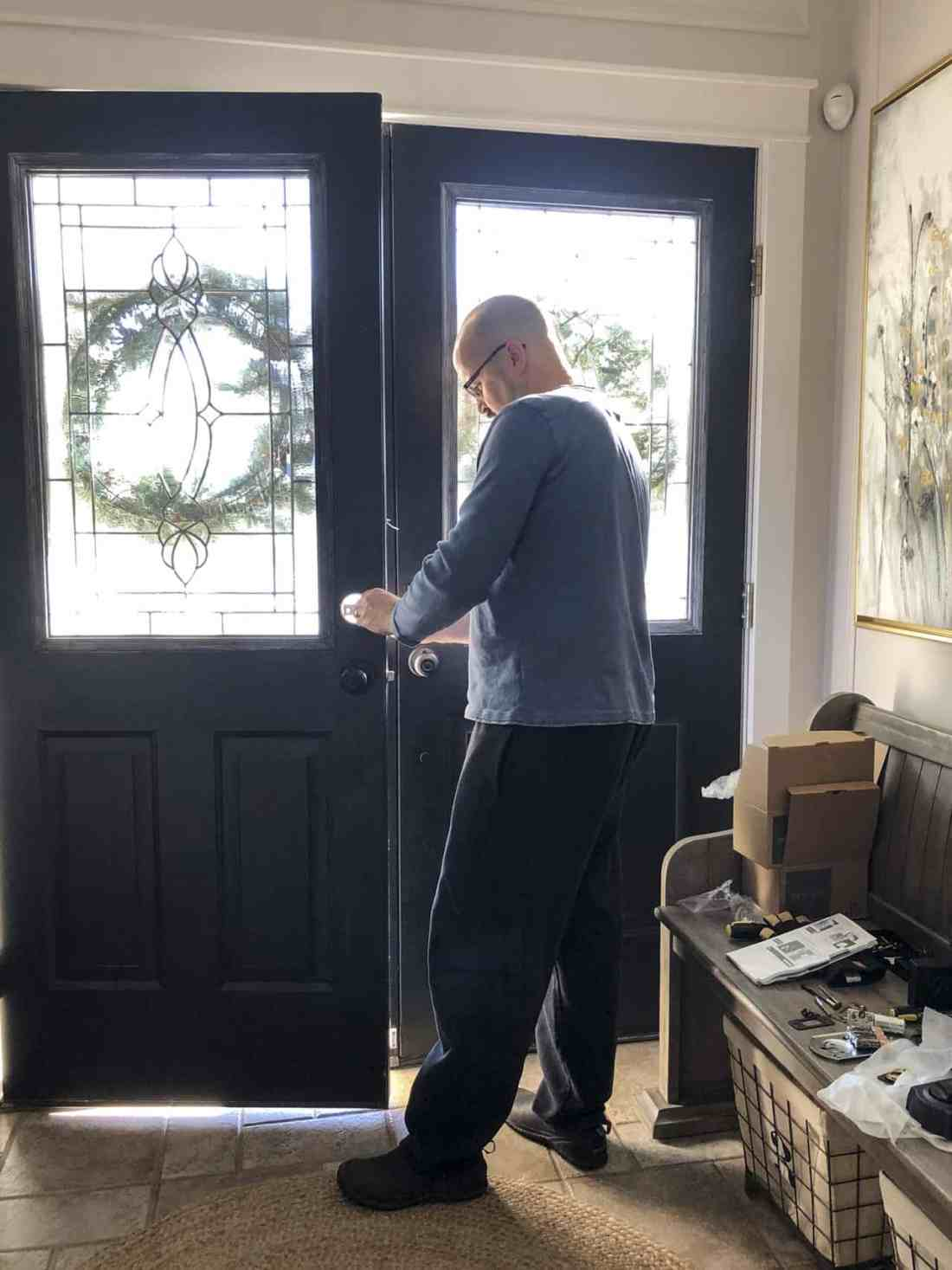 Dean installing front door locks