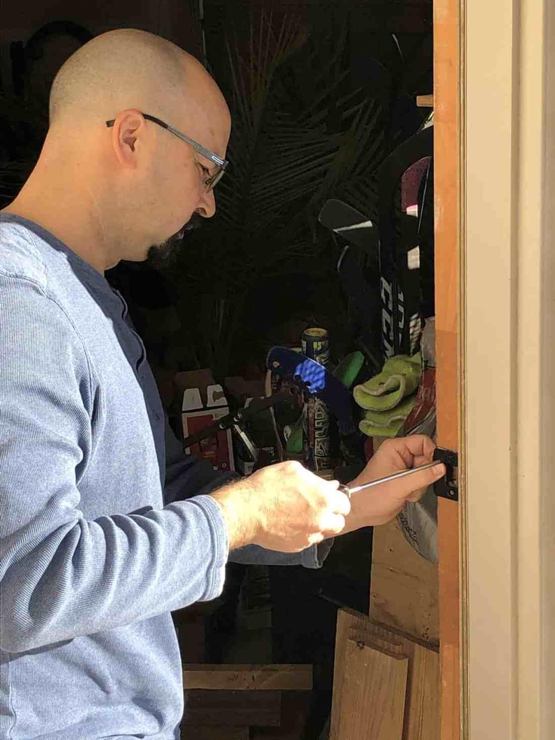 Dean working on garage door