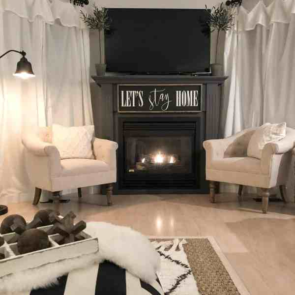 Lordana Barrel Chairs by fireplace night