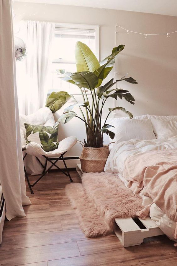 The living room is one of the most important areas in your house for a great hosting experience. nature-boho-bedroom-with-large-plants | HomeMydesign