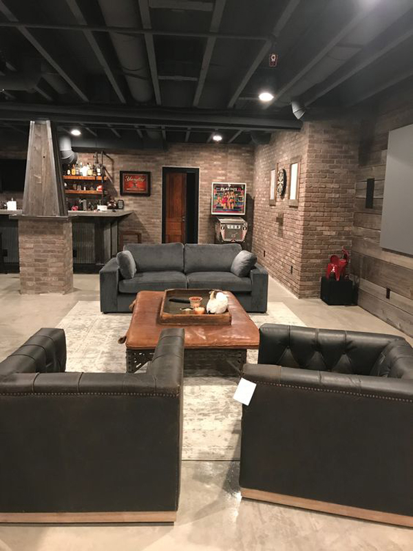 Contemporary living room design with a fireplace and a large sofa. 35 Industrial Man Cave Ideas To Liven Up Your Style