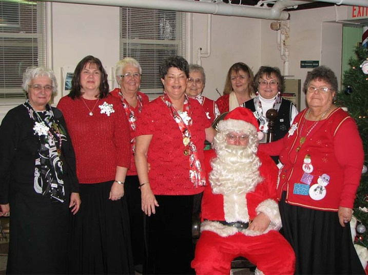 the Rebekah Assembly President and her team with Santa