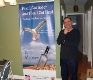 Dan with Banner for Book