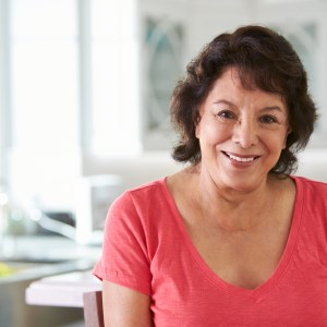 Head And Shoulders Portrait Of Senior Hispanic Woman At Home