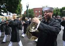 170610-N-LQ926-126 PORTLAND Ore., (June 10, 2017) – Sailors with Navy Band Northwest participate in the Rose Festival Parade in Portland, Ore., during Portland Rose Festival Fleet Week. The festival and Portland Fleet Week are a celebration of the sea services with Sailors, Marines, and Coast Guard members from the U.S. and Canada making the city a port of call. (U.S. Navy photo by Mass Communication Specialist 2nd Class Alex Van'tLeven /Released)