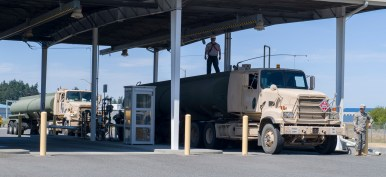 170720-N-KH214-019 OAK HARBOR, Wash. (July 20, 2017) United States Army 475th Quartermaster Group fuel trucks arrive at Naval Air Station Whidbey Island to offload fuel during the 2017 Quartermaster Liquid Logistics Exercise (QLLEX). QLLEX is an annual exercise for Army Reserve units to train for their wartime mission of providing petroleum and water to units throughout the continental United States. This year's exercise had convoys of Army trucks based out of Joint Base Lewis-McCord (JBLM) transporting fuel provided by Naval Supply Systems Command Fleet Logistics Center Puget Sound's Manchester Fuel Depot to military installations around Puget Sound and throughout western Washington. (U.S. Navy photo by Mass Communication Specialist 2nd Class Scott Wood/Released)