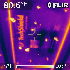 Cooler roof decking with reflective coating
