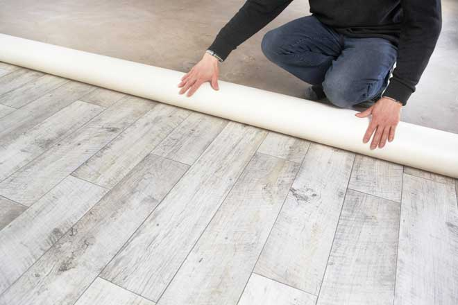 Vinyl Flooring Being Rolled Out