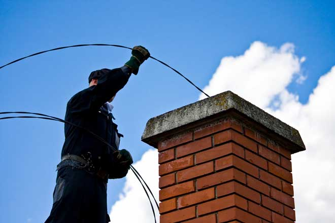 Chimney Sweep Cleaning a Chimney