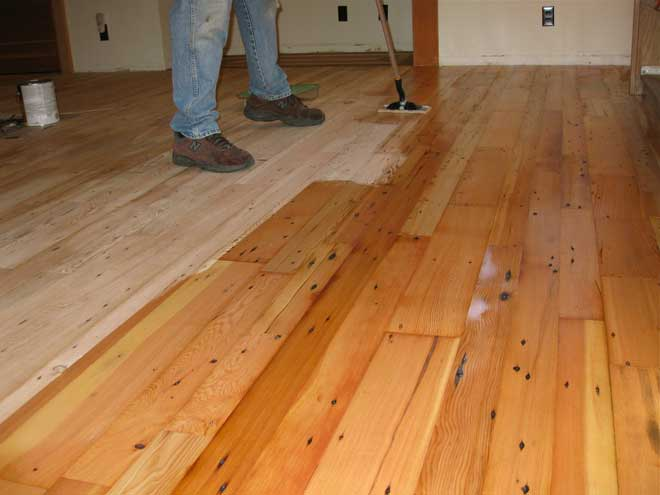 Finish Being Applied to Newly Installed Wood Floor