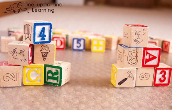 """We play """"Can you make it?"""" with the blocks."""