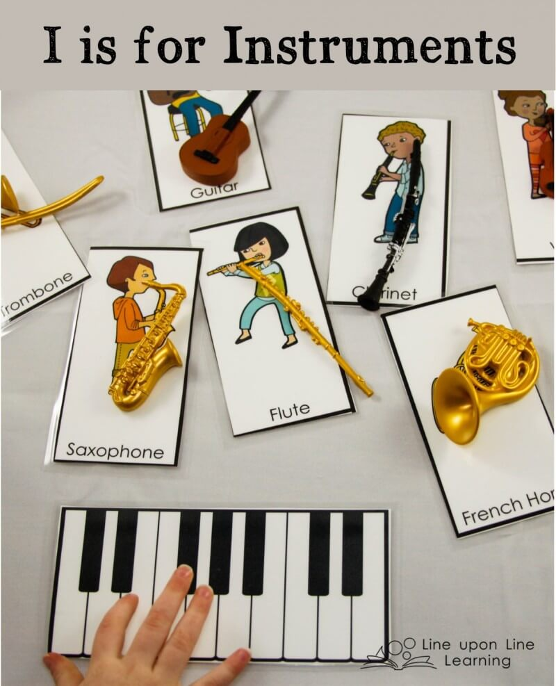 We match the plastic model instruments to the instrument cards. My daughter likes to pretend to play the instruments too.