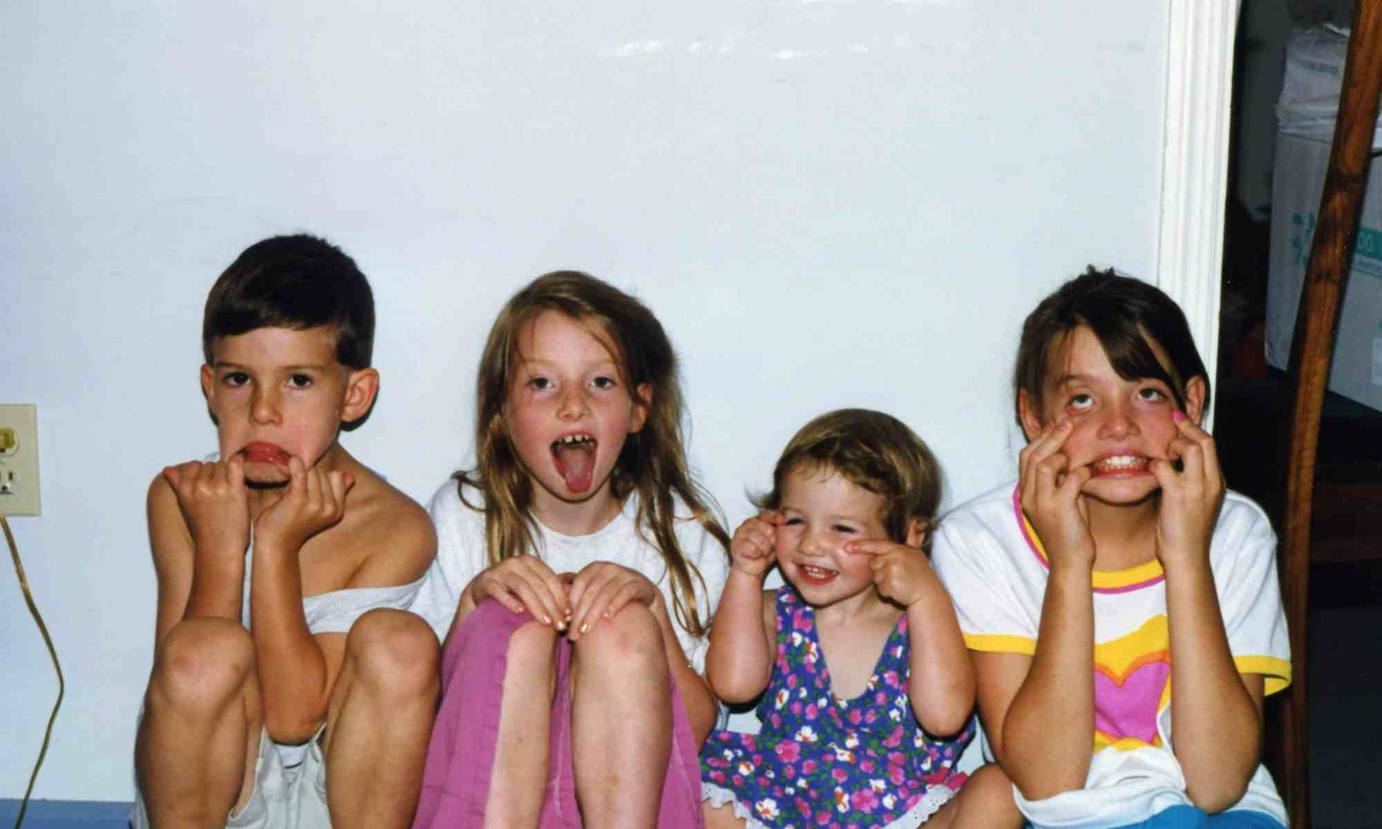4 kids making silly faces at the camera
