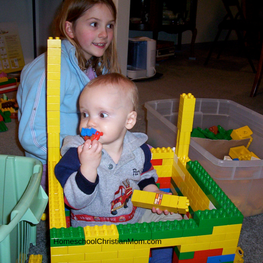 Homeschool Christian Mom: young child playing with building blocks with toddler