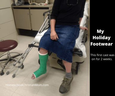 I am sitting in the cast room at the hospital with my broken foot in a green cast.