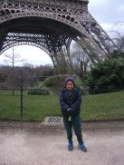 boy in front of eiffel tower