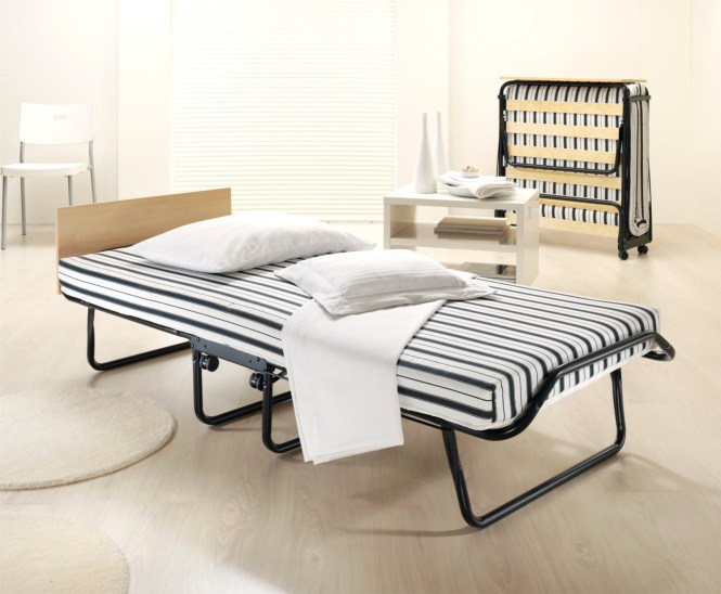 Folding Bed With Striped Mattres And White Pillows Are Perfect For Guest Solution