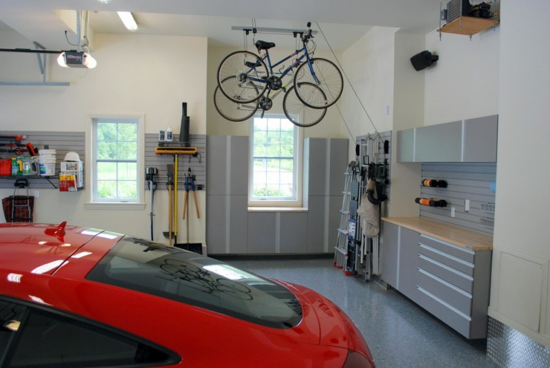 contemporary garage idea in grey and white hanging bikes