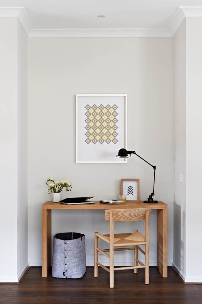 contemporary home office idea all white wall system wood working table and chair without finishing dark toned wood floors modern black table lamp