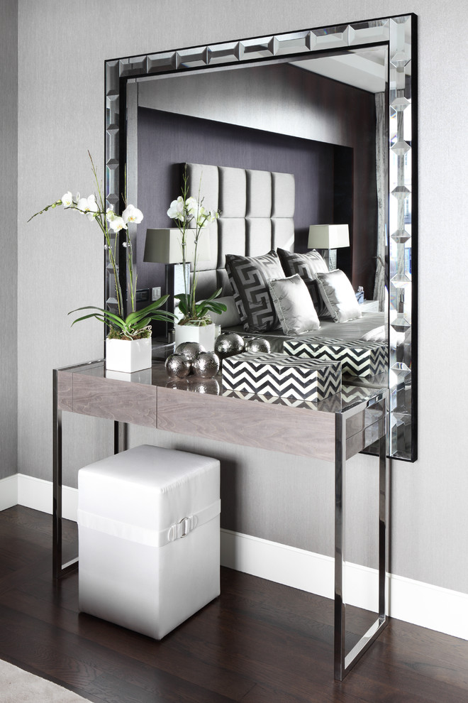 contemporary makeup vanity dominated by chrome and mirror finishings white vanity bench