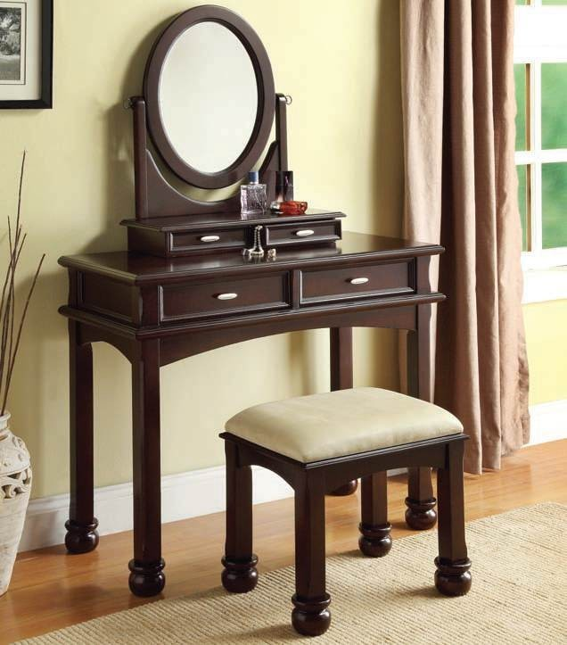 dark toned dressing table with round mirror and layered drawers