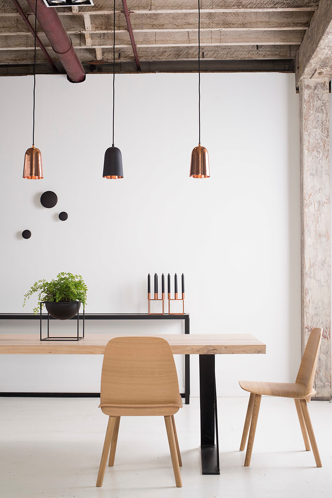 industrial dining room oak top dining table with black steel base oak reclaimed dining chair black steel hall console with potted plant long wired pendant lamps with reddish gold shades