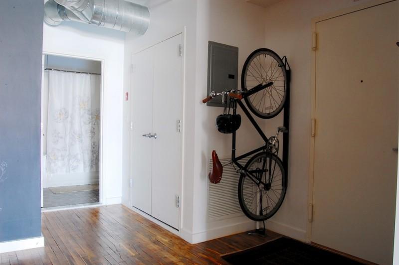 industrial entry hall idea vertical wall bike rack rustic style wood floors