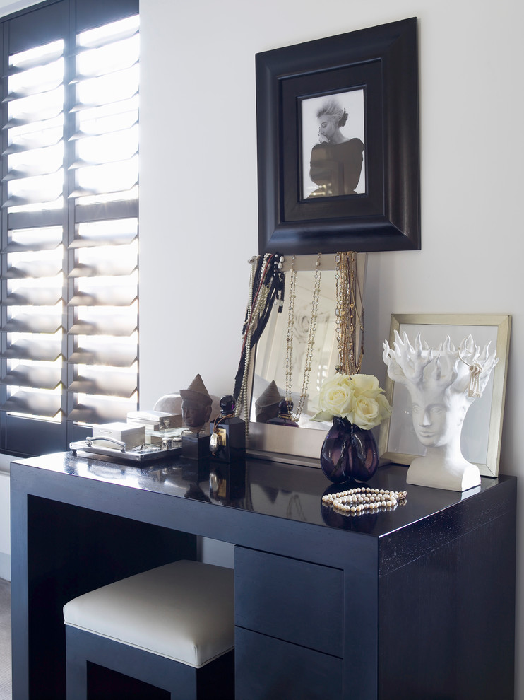 simple makeup vanity table in black with medium sized standing mirror some ornaments