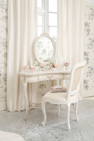 soft peach French style makeup vanity with built in mirror shabby chic vanity chair flower wallpapers light grey carpet with silver accents